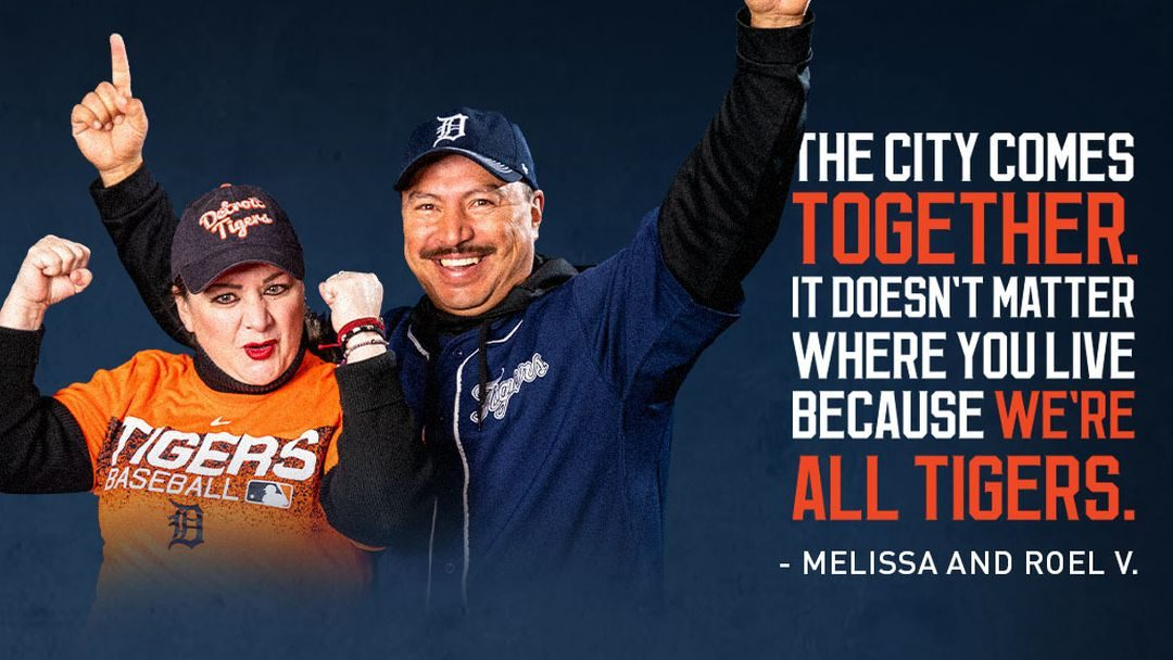 Detroit Tigers fans Melissa and Roel V root for their team.