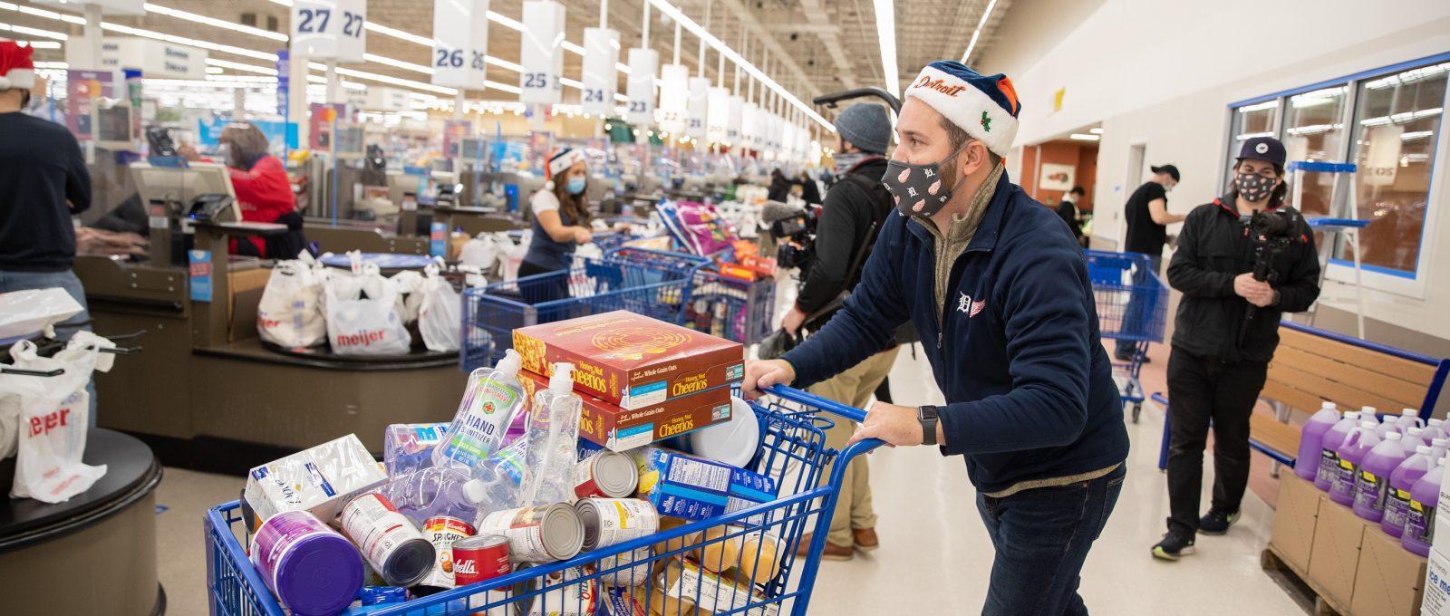 Man pushing his cart full of groceries