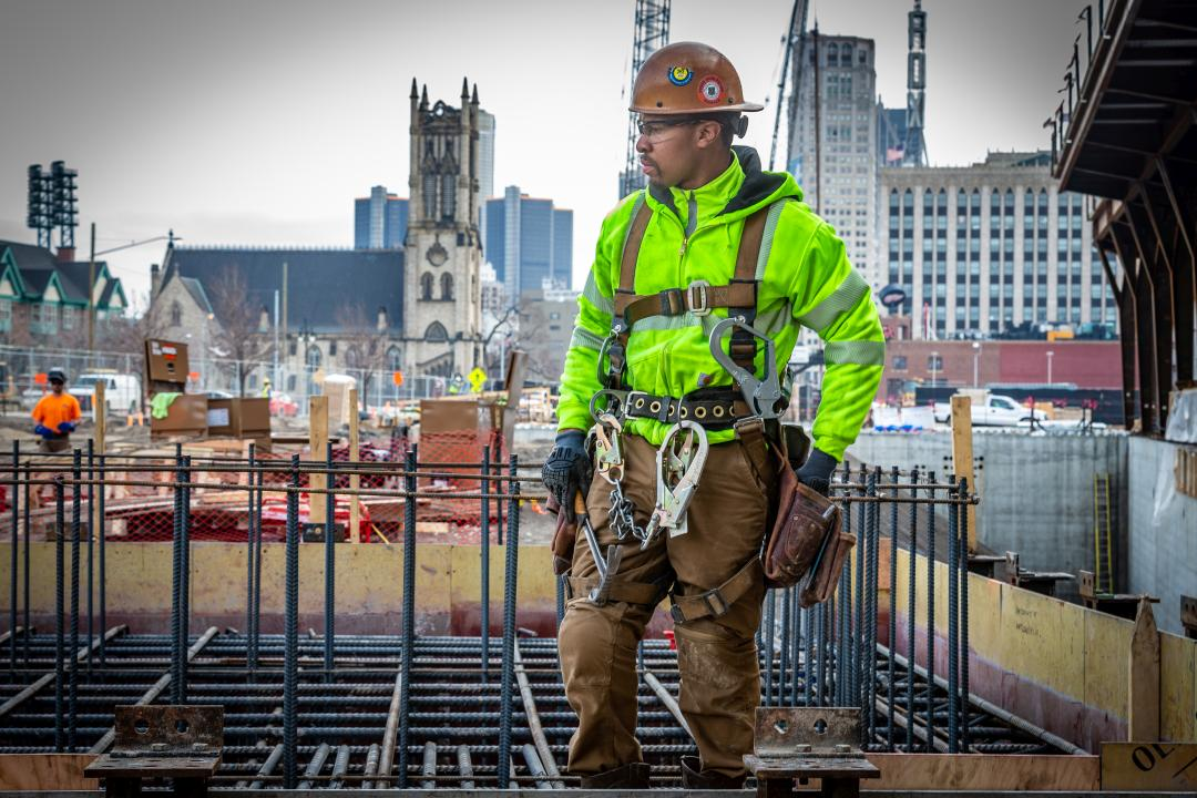 Construction worker standing at a work site